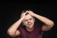 Portrait of Man Holding His Head in Stress. Stock Image