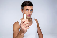 Portrait of a man holding lipstick Royalty Free Stock Photos