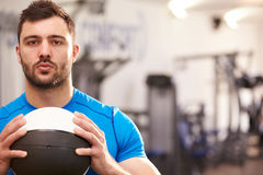 Portrait of a man holding medicine ball at a gym, copy space Stock Photos