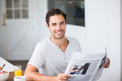 Portrait of man holding newspaper Royalty Free Stock Images