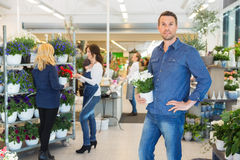 Portrait Of Man Holding Pot Plant In Flower Shop Royalty Free Stock Images