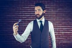 Portrait of man holding razor Royalty Free Stock Photography