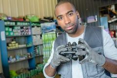 Portrait man holding second hand automobile part Stock Images