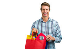 Portrait of man holding shopping bags Royalty Free Stock Image