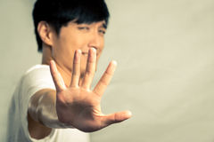 Portrait of man holding up his hand Stock Image