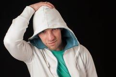 Portrait of Man in hood Stock Photo