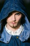Portrait of man with hood looking at camera Royalty Free Stock Image