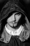 Portrait of man with hood looking at camera Royalty Free Stock Photography