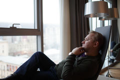 Man in hotel room Stock Image