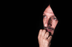 Portrait of a Man with interior drama - Black background Royalty Free Stock Image