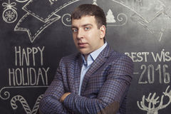 Portrait of a man in a jacket against the wall inscribed Stock Image