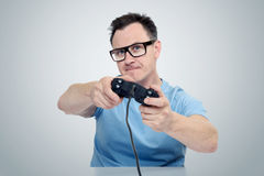 Portrait man with a joystick playing in game. Gamer concept Royalty Free Stock Photos