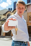 Portrait of a man with a key of new house Stock Images