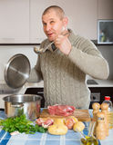 Portrait of man at kitchen Stock Photos
