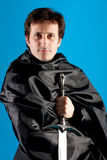Portrait of man with a knight sword Stock Photography