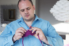 Portrait of a man knitting Royalty Free Stock Image