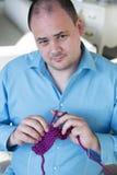 Portrait of a man knitting Stock Photo