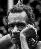 Portrait of a man Korowai tribe. Close-up. Tribe of Korowai Kombai , Kolufo. Royalty Free Stock Image