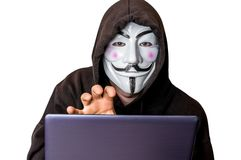Portrait of man with laptop and vendetta mask isolated on white Stock Image