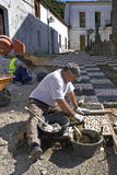 Portrait of man laying new sidewalk, Spain Royalty Free Stock Photo