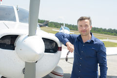 Portrait man leaning on aircraft Stock Images