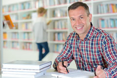 Portrait man in library. Portrait of man in library Stock Photography
