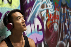 Portrait of a man listening to music on his headphones Royalty Free Stock Image