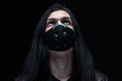 Portrait of the man with long hair in mask Royalty Free Stock Photo