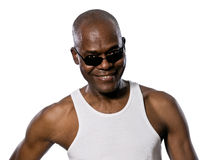 Portrait of man looking through sunglasses. Portrait of an afro American man looking through sunglasses in studio on white isolated background Royalty Free Stock Image