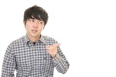 Uneasy Asian man. Portrait of man looking uneasy royalty free stock image