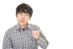 Uneasy Asian man. Portrait of man looking uneasy royalty free stock photos