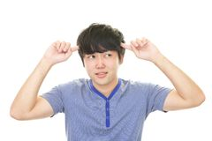 Uneasy Asian man. Portrait of man looking uneasy stock photo