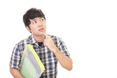 Uneasy Asian man. Portrait of man looking uneasy royalty free stock images
