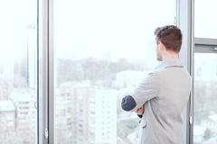 Portrait of man looking in window Royalty Free Stock Photo