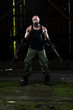 Portrait Of A Man With Machine Gun Stock Photo