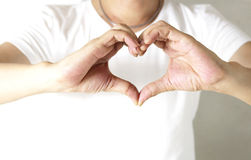 Portrait of man making heart shape Stock Images
