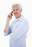 Portrait of a man making a phone call while looking at the camer Royalty Free Stock Photo