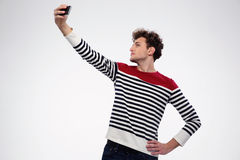 Portrait of a man making selfie photo Stock Images