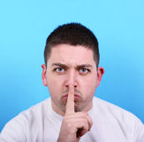 Portrait of man making silence gesture Royalty Free Stock Images