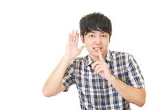 Man placing finger on lips. Portrait of a man making silence gesture stock images