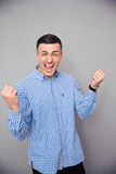 Portrait of a man making victory gesture Royalty Free Stock Photo