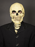 Portrait of man in mask of death Stock Image