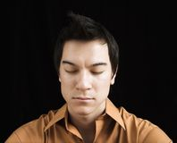 Portrait of man meditating. Stock Photo
