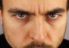 Portrait of a man, menacing look, closeup Royalty Free Stock Photos