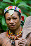 Portrait of a man Mentawai tribe in traditional headdress. MENTAWAI PEOPLE, WEST SUMATRA, SIBERUT ISLAND, INDONESIA – 16 NOVEMBER 2010: Portrait of a man Royalty Free Stock Photos