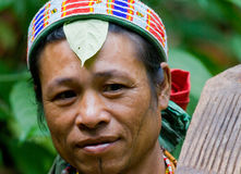 Portrait of a man Mentawai tribe in traditional headdress. MENTAWAI PEOPLE, WEST SUMATRA, SIBERUT ISLAND, INDONESIA – 16 NOVEMBER 2010: Portrait of a man Royalty Free Stock Photography