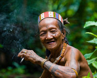 Portrait of a man Mentawai tribe in traditional headdress. MENTAWAI PEOPLE, WEST SUMATRA, SIBERUT ISLAND, INDONESIA – 16 NOVEMBER 2010: Portrait of a man Royalty Free Stock Image