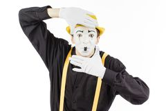 Portrait of a man, MIME, looking at camera and showing frame fin Stock Photography