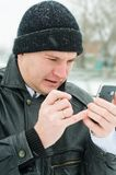 Portrait of the man with a mobile phone. Stock Images