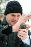 Portrait of the man with a mobile phone. Royalty Free Stock Photos